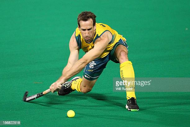 Liam DeYoung of the Kookaburras hits the ball in the game against Pakistan during day one of the 2012 International Super Series at Perth Hockey...