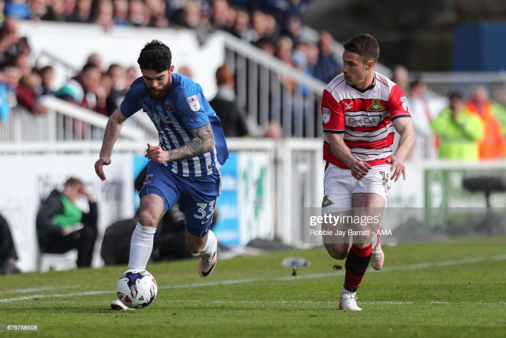 Liam Donnelly of Hartlepool United and Tommy Rowe of Doncaster Rovers during the Sky Bet League Two match between Hartlepool United and Doncaster Rovers at Victoria Park on May 6, 2017 in Hartlepool, England.