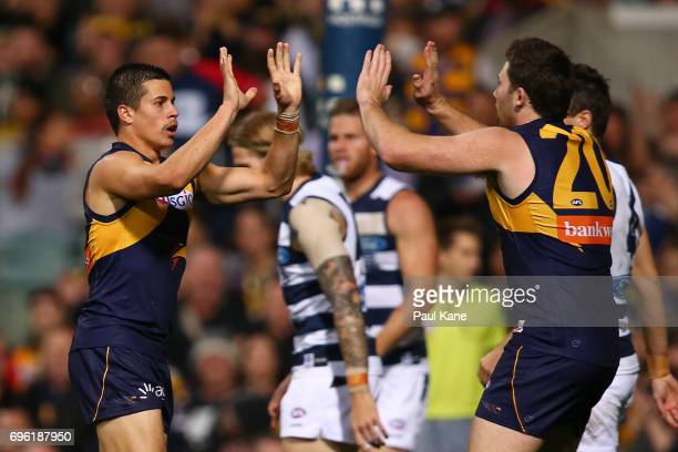 Liam Duggan and Jeremy McGovern of the Eagles celebrate a goal during the round 13 AFL match between the West Coast Eagles and the Geelong Cats at...