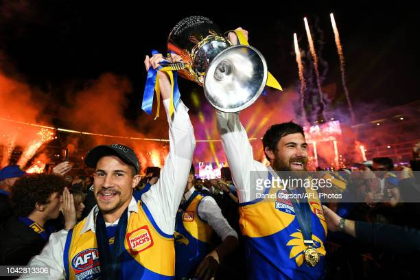 Liam Duggan and Josh Kennedy of the Eagles walks the Premiership Cup though their fans during the 2018 Toyota AFL Grand Final match between the West...