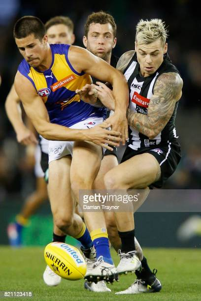 Liam Duggan of the Eagles and Jamie Elliott of the Magpies compete for the ball during the round 18 AFL match between the Collingwood Magpies and the...