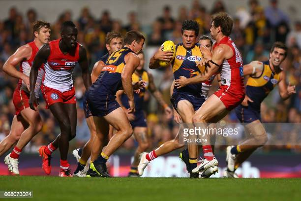 Liam Duggan of the Eagles attempts to break from a tackle by Nick Smith of the Swans during the round four AFL match between the West Coast Eagles...