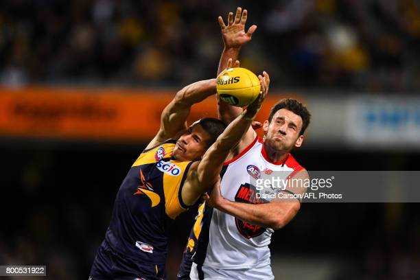 Liam Duggan of the Eagles competes for a mark with Cameron Pedersen of the Demons during the 2017 AFL round 14 match between the West Coast Eagles...