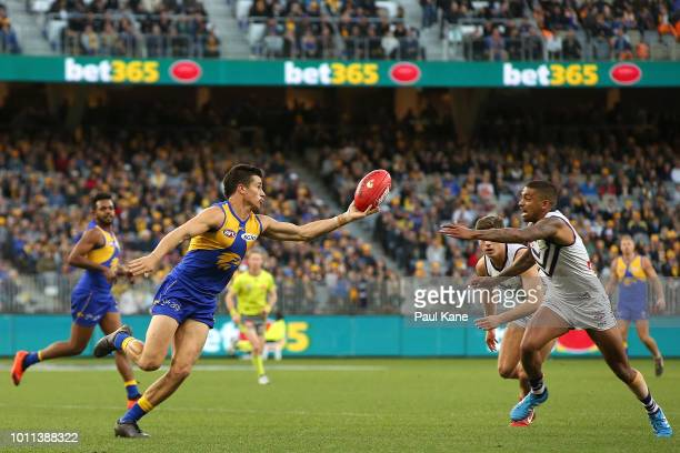 Liam Duggan of the Eagles gathers the ball against Bradley Hill of the Dockers during the round 20 AFL match between the West Coast Eagles and the...