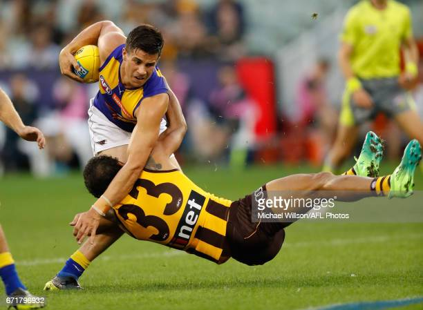 Liam Duggan of the Eagles is tackled by Cyril Rioli of the Hawks during the 2017 AFL round 05 match between the Hawthorn Hawks and the West Coast...