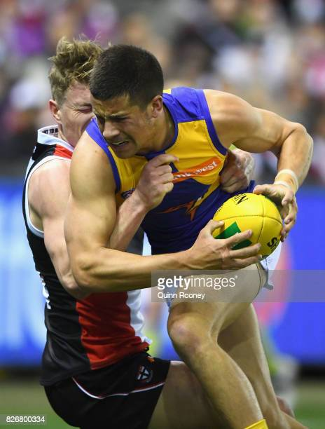 Liam Duggan of the Eagles is tackled by Jack Newnes of the Saints during the round 20 AFL match between the St Kilda Saints and the West Coast Eagles...