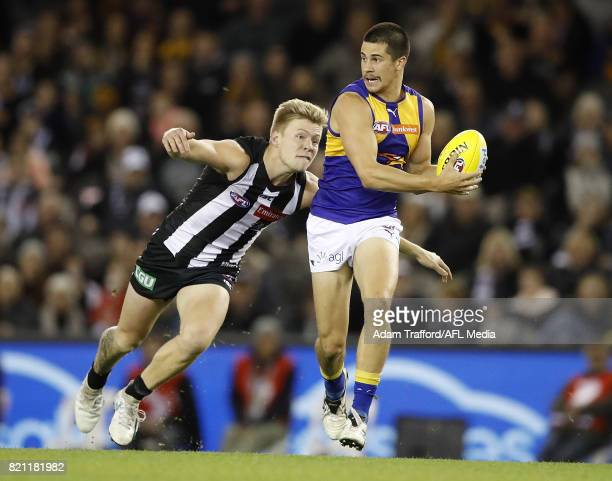 Liam Duggan of the Eagles is tackled by Jordan De Goey of the Magpies during the 2017 AFL round 18 match between the Collingwood Magpies and the West...