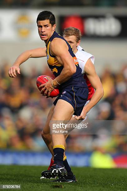 Liam Duggan of the Eagles looks to pass the ball during the round 18 AFL match between the West Coast Eagles and the Melbourne Demons at Domain...