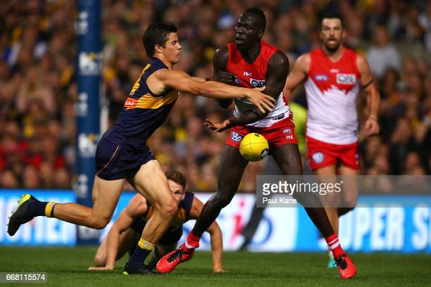 Liam Duggan of the Eagles tackles Aliir Aliir of the Swans during the round four AFL match between the West Coast Eagles and the Sydney Swans at...