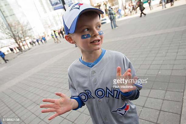 Liam Dunlop of Guelph starts chanting 'Lets Go Blue Jays' as he waits near the Gate 5 to enter Toronto Blue Jays fans get to the Rogers Centre early...