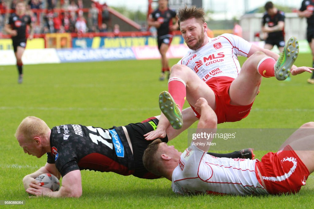Liam Farrell of Wigan Warriors attempts to cross the Try line during round six of the Ladbrokes Challenge Cup at KCOM Craven Park on May 13, 2018 in Hull, England.