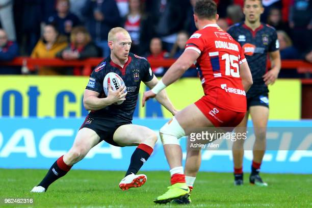 Liam Farrell of Wigan Warriors looks for a gap to run through during the Betfred Super League at KCOM Craven Park on May 25, 2018 in Hull, England.