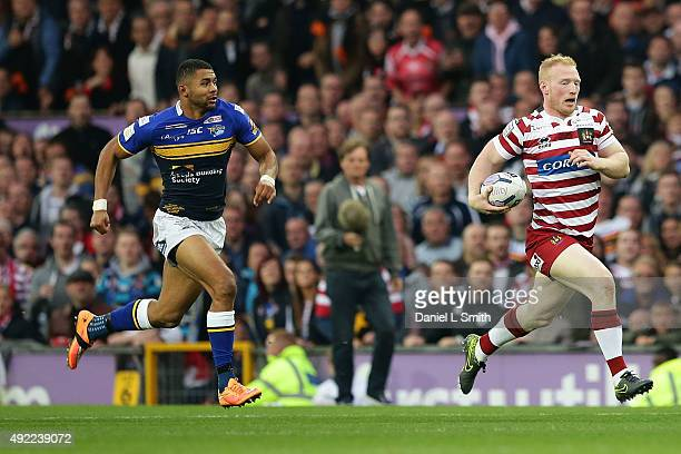 Liam Farrell of Wigan Warriors runs with possession from Ryan Hall of Leeds Rhinos during the First Utility Super League Grand Final between Leeds...