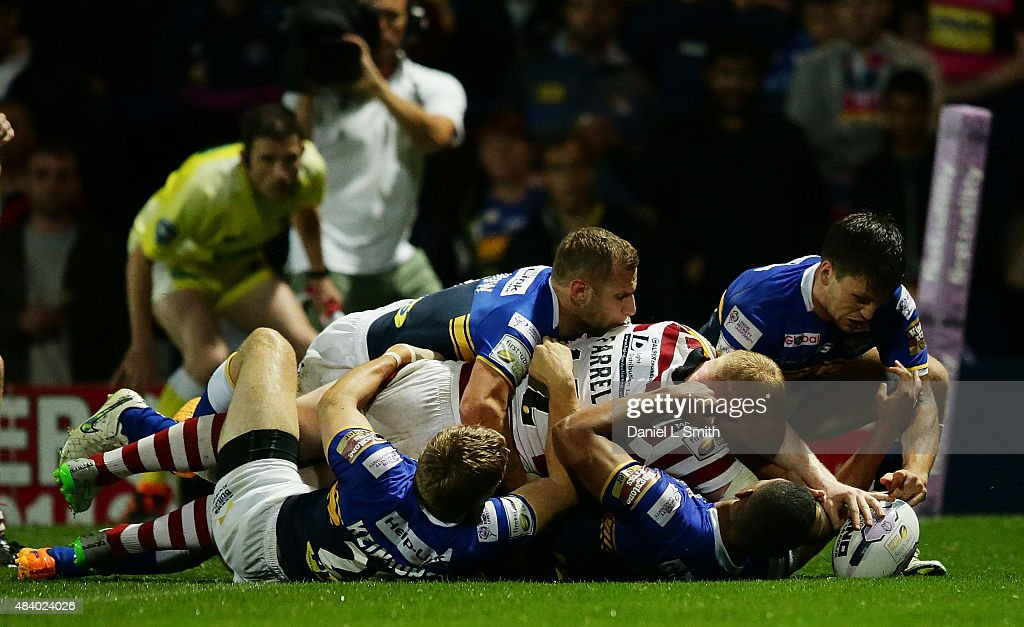 Liam Farrell of Wigan Warriors touches the ball over the line during the Round 2 match of the First Utility Super League Super 8s between Leeds Rhinos and Wigan Warriors at Headingley Carnegie Stadium on August 14, 2015 in Leeds, England.