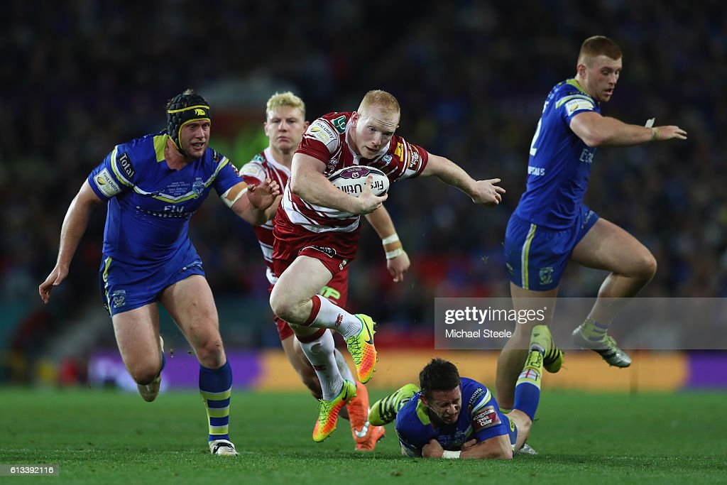Liam Farrell of Wigan winner of the man of the match award breaks through the Warrington defence to set up his sides first try during the First Utility Super League Final between Warrington Wolves and Wigan Warriors at Old Trafford on October 8, 2016 in Manchester, England.