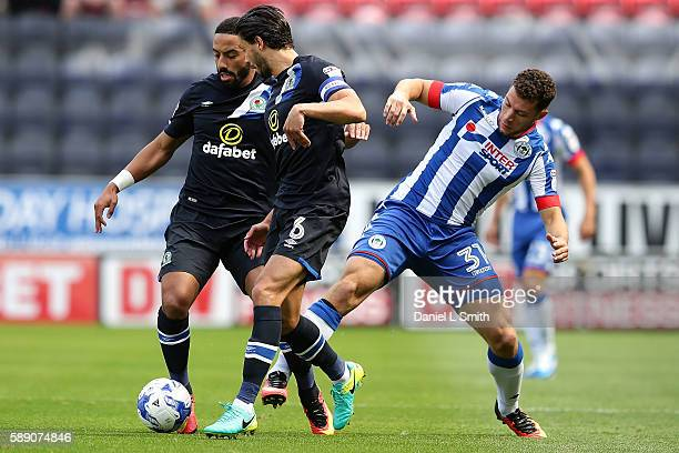 Liam Feeney of Blackburn Rovers maintains control over Yanic Wildschut of Wigan Athletic during the Sky Bet Championship League match between Wigan...