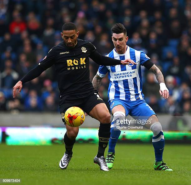 Liam Feeney of Bolton holds the ball up from Brighton's Liam Ridgewell during the Sky Bet Championship match between Brighton and Hove Albion and...