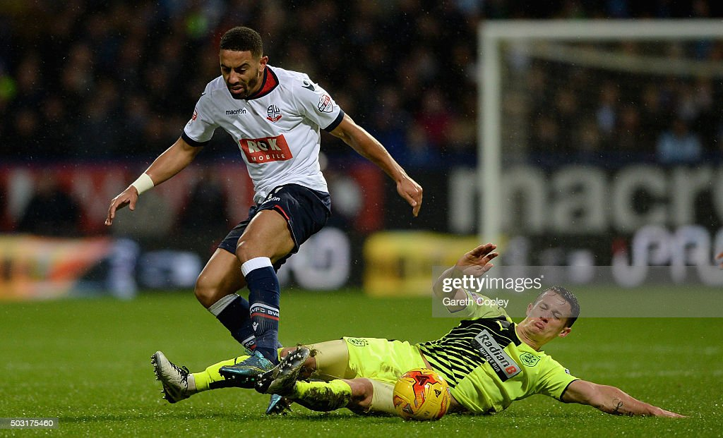 Liam Feeney of Bolton is tackleby Jonathan Hogg of Huddersfield Town during the Sky Bet Championship match between Bolton Wanderers and Huddersfield Town at the Macron Stadium on January 2, 2016 in Bolton, United Kingdom.