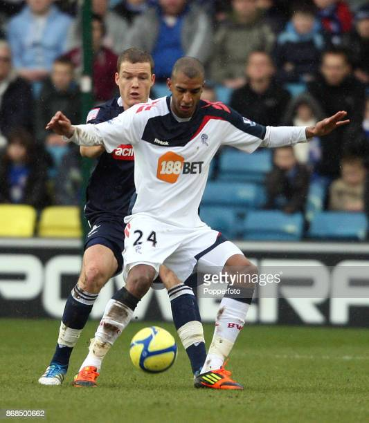 Liam Feeney of Millwall and David Ngog of Bolton Wanderers in action during a FA Cup 5th Round match at the City Ground on February 18 2012 in London...