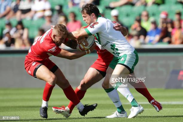 Liam Finn of Ireland is tackled by Courtney Davies of Wales during the 2017 Rugby League World Cup match between Wales and Ireland at nib Stadium on...