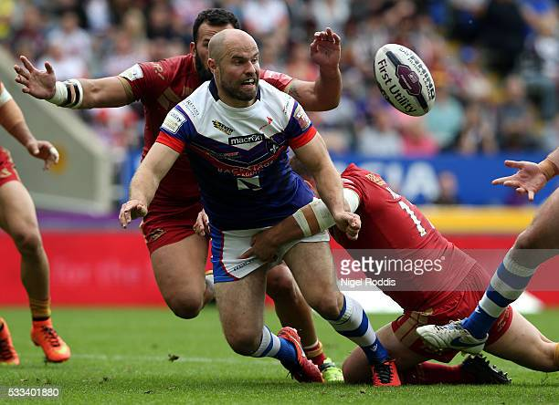 Liam Finn of Wakefield Wildcats tackled by Louis Anderson and Gregory Mounis of Catalans Dragons during the First Utility Super League match between...