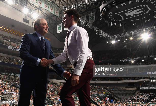 Liam Foudy greets NHL commissioner Gary Bettman after being selected eighteenth overall by the Columbus Blue Jackets during the first round of the...