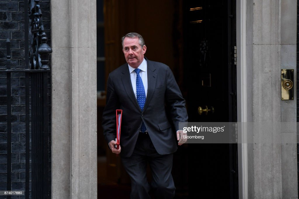 Liam Fox, U.K. international trade secretary, leaves following a cabinet meeting at number 10 Downing Street in London, U.K., on Tuesday, Nov. 14, 2017. Analysts are more optimistic than the U.K. government that an agreement will be reached with the European Union next month to move Brexit talks on to trade even as Theresa Mays political troubles continue to weigh on the countrys beleaguered currency. Photographer: Chris J. Ratcliffe/Bloomberg via Getty Images