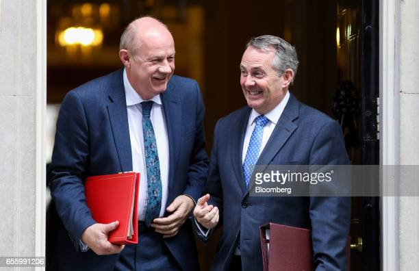 Liam Fox UK international trade secretary right and Damian Green UK work and pensions secretary depart following the weekly cabinet meeting at...
