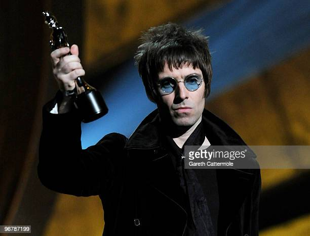 Liam Gallagher accepts Oasis' award for 'Best Album of 30 Years' on stage at The Brit Awards 2010 at Earls Court on February 16, 2010 in London,...