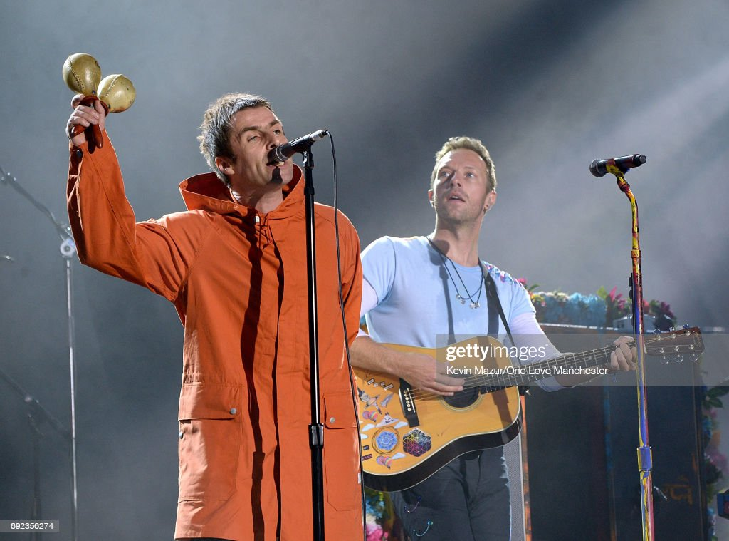 Liam Gallagher (L) and Chris Martin of Coldplay perform on stage during the One Love Manchester Benefit Concert at Old Trafford Cricket Ground on June 4, 2017 in Manchester, England.