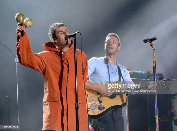 Liam Gallagher and Chris Martin of Coldplay perform on stage during the One Love Manchester Benefit Concert at Old Trafford Cricket Ground on June 4,...