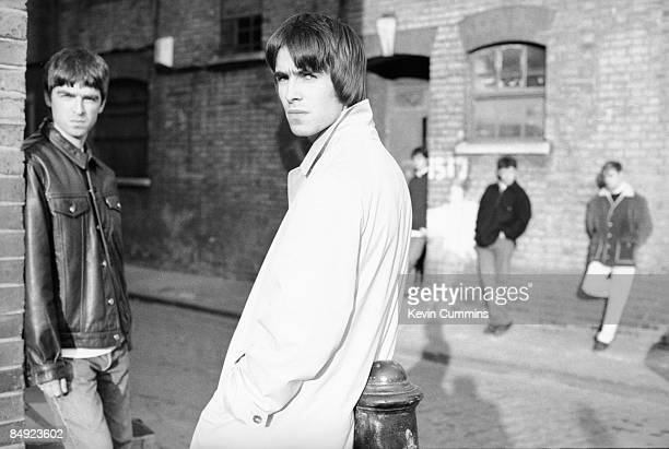 Liam Gallagher and guitarist brother Noel Gallagher of Manchester rock band Oasis, outside the London offices of their record label, Creation, with...