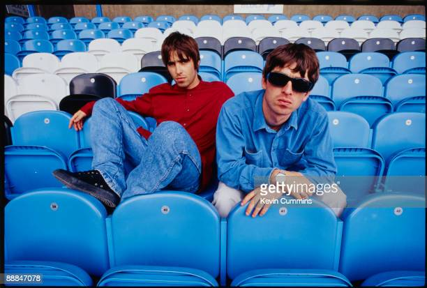 Liam Gallagher and his brother Noel singer and guitarist respectively of British rock band Oasis at Manchester City's Maine Road stadium Manchester...