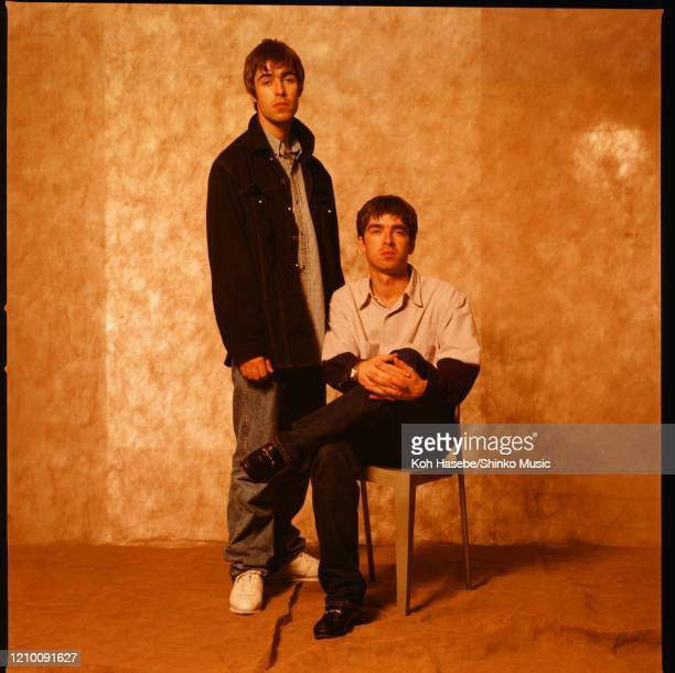 Liam Gallagher and Noel Gallagher of Oasis, at a photoshoot in a hotel in Tokyo, September 1994.
