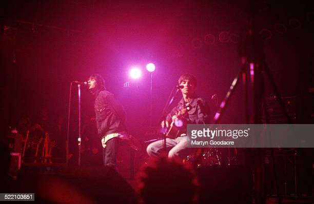 Liam Gallagher and Noel Gallagher of Oasis perform on stage at The Electric Ballroom, Camden, London, United Kingdom, 9th May 1996.