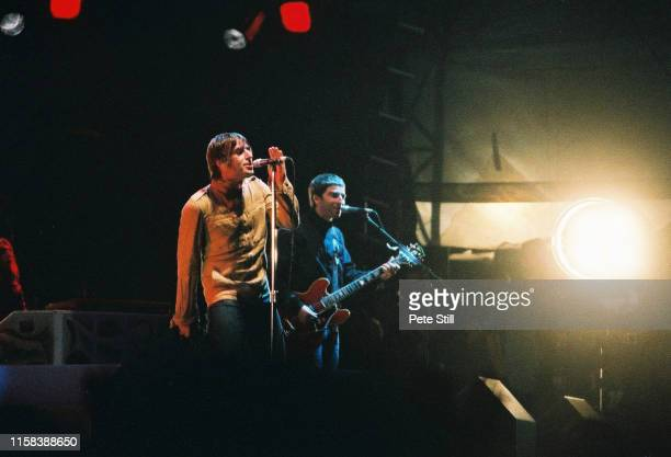 Liam Gallagher and Noel Gallagher of Oasis perform on stage in Finsbury Park, on July 6th 2002, London, England.