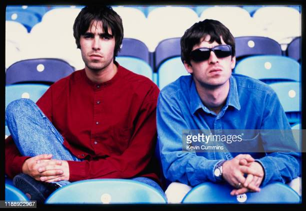 Liam Gallagher and Noel Gallagher singer and guitarist respectively of British rock band Oasis at Manchester City's Maine Road stadium Manchester UK...