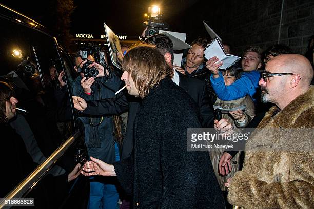Liam Gallagher and Paul 'Bonehead' Arthurs leave the 'Oasis: Supersonic' German premiere on October 27, 2016 in Berlin, Germany.