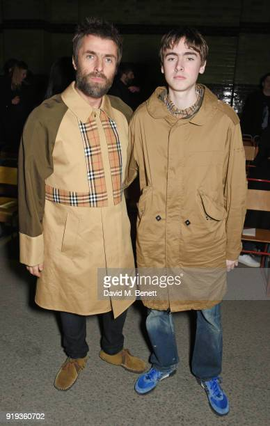 Liam Gallagher and son Gene Gallagher wearing Burberry at the Burberry February 2018 show during London Fashion Week at Dimco Buildings on February...