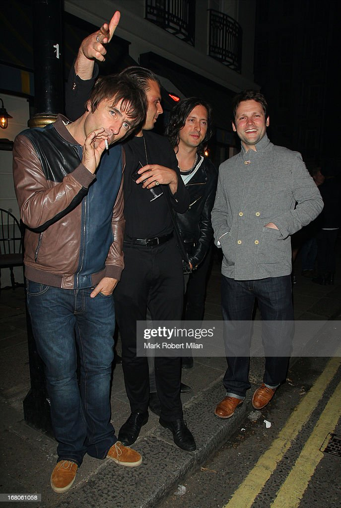 Liam Gallagher, Carl Barat and Gordon Smart at The Little House club on May 4, 2013 in London, England.
