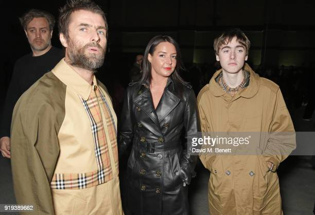Liam Gallagher Debbie Gwyther and Gene Gallagher wearing Burberry at the Burberry February 2018 show during London Fashion Week at Dimco Buildings on...