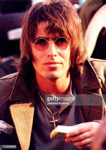 Liam Gallagher of Oasis sits in the crowd before the Sex Pistols' reunion gig at Finsbury Park London 26th June 1996