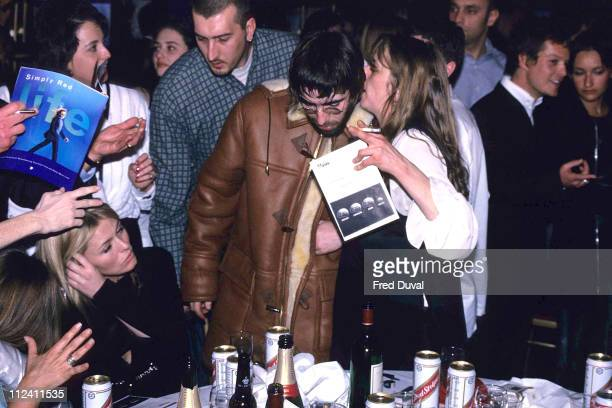 Liam Gallagher of Oasis with Patsy Kensit at the Brit Awards in 1996