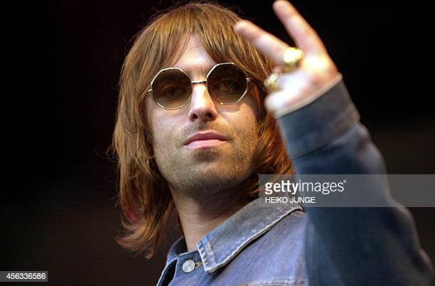 Liam Gallagher of the British rock group Oasis gestures during the group's concert during the Quart Festival in Kristiansand southern Norway 06 July...