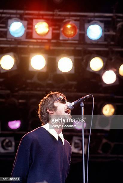 Liam Gallagher performs on stage with Oasis at Glastonbury Festival United Kingdom 1994