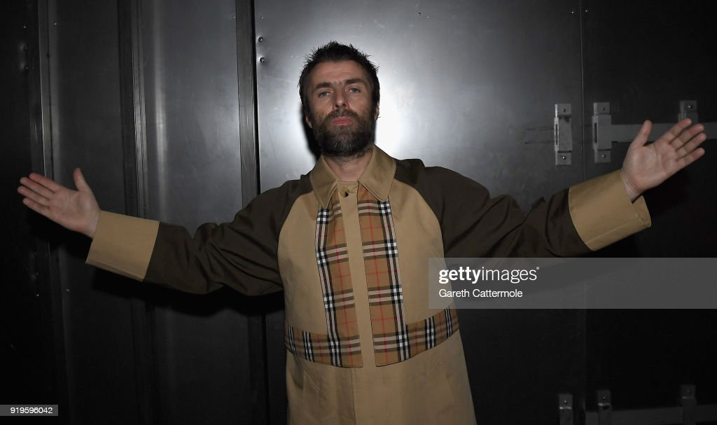 Liam Gallagher wearing Burberry at the Burberry February 2018 show during London Fashion Week at Dimco Buildings on February 17, 2018 in London, England.