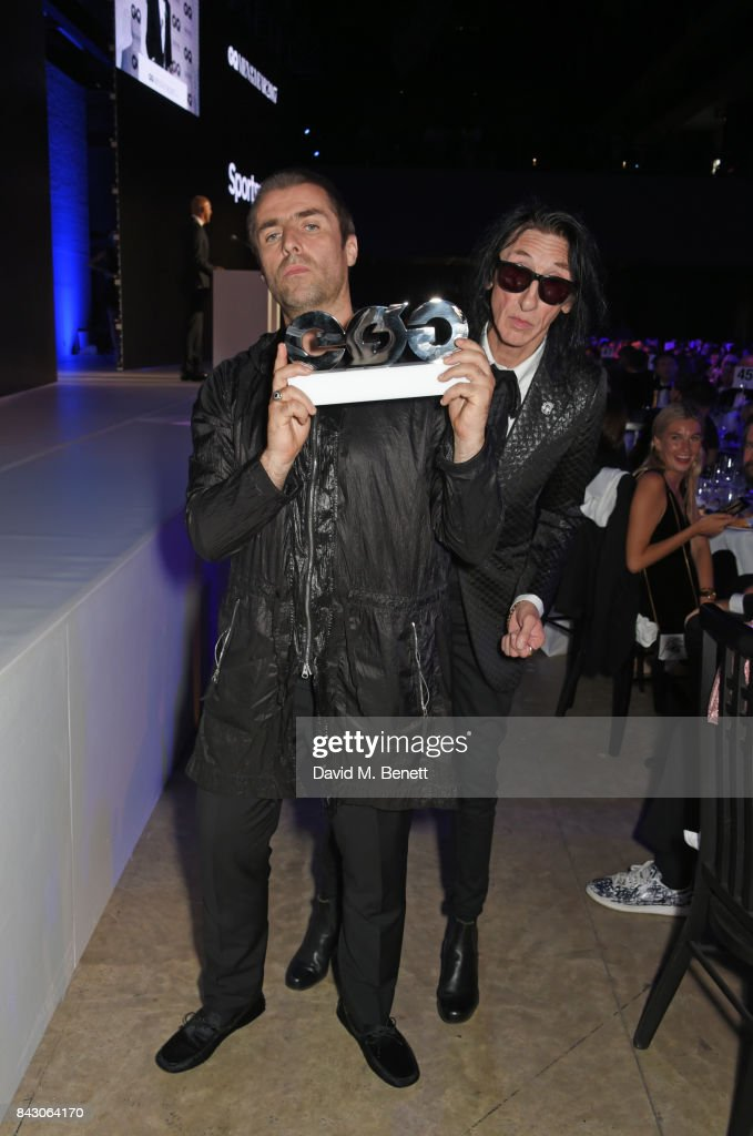 Liam Gallagher, winner of the Rock n'Roll Star of the Year award, and John Cooper Clarke attend the GQ Men Of The Year Awards at the Tate Modern on September 5, 2017 in London, England.