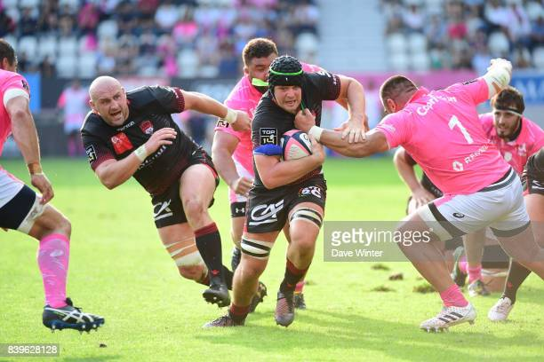 Liam Gill of Lyon makes a break during the Top 14 match between Stade Francais Paris and Lyon OU at Stade Jean Bouin on August 26 2017 in Paris France