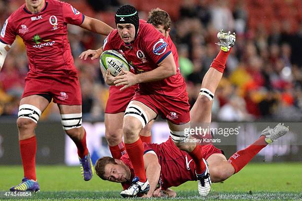 Liam Gill of the Reds breaks away from the defence during the round 15 Super Rugby match between the Reds and the Sharks at Suncorp Stadium on May 22...