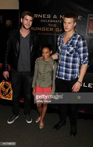 Liam Hemsworth Amandla Stenberg and Alexander Ludwig of Lionsgate's 'The Hunger Games' pose at Barnes Noble bookstore at The Grove on March 22 2012...